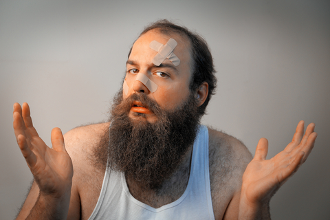 http://www.dreamstime.com/stock-photography-bandaged-bearded-sad-man-shrugs-his-hands-confusion-image41966882