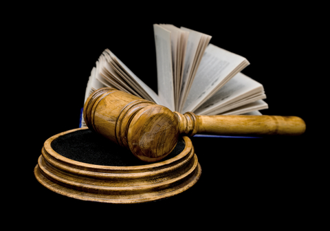http://www.dreamstime.com/royalty-free-stock-photography-gavel-book-black-background-closeup-image28250587