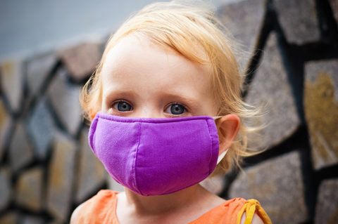 http://www.dreamstime.com/royalty-free-stock-photo-cute-little-girl-bright-face-mask-image47189975