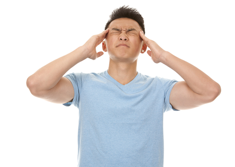 http://www.dreamstime.com/stock-photo-man-headache-casual-wearing-blue-tshirt-jeans-dark-background-image31791190